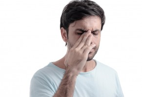 Sinus Pain, Sinus Pressure, Sinusitis. Sad Man Holding His Nose